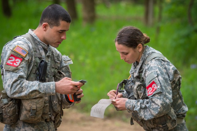 First Lt. Edward Colon and 2nd Lt. Leah Mullenix, representing 326th Brigade Engineer Battalion, Fort Campbell, Ken., consult their notes, before taking on the next task during the Sapper Stakes portion of the competition. Team 23 ended the competition in 7th overall.