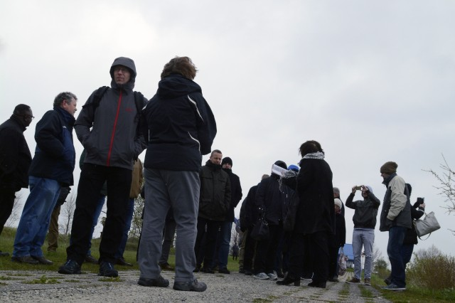 U.S. and German signal leaders stand along the Path of Hope, the former East German border patrol road now transformed into an outdoor art exhibition and nature preserve, during a staff ride April 27, 2016 at the Point Alpha Memorial near Geisa, Germany.