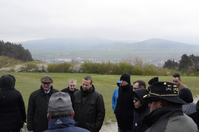 U.S. and German signal leaders listen to a discussion about Soviet war planning and armored avenues of approach through the Fulda Gap April 27, 2016 at the Point Alpha Memorial near Geisa, Germany.