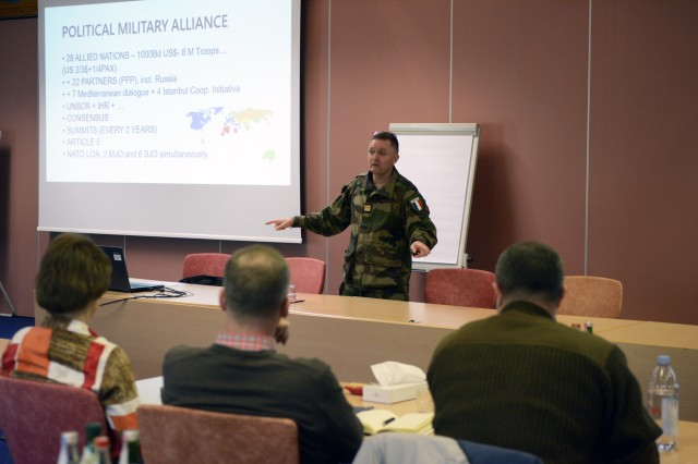 "Col. Frederic Curtaz, French liaison officer to U.S. Army Europe, delivers a presentation about ""How NATO Works"" to a group of U.S. and German signal leaders during a joint staff ride to the Point Alpha Memorial April 28, 2016 in Hohenroda, Germany."