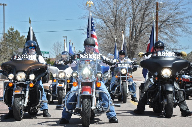 FORT CARSON, Colo. -- Members of a color guard prepare to leave McMahon Auditorium to commence the safety ride as part of the Iron Horse Kickstart 2016 Motorcycle Safety Rally April 21, 2016.