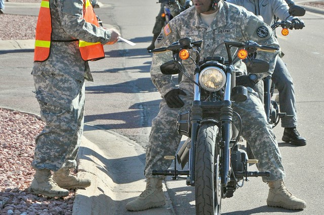 FORT CARSON, Colo. -- A group of riders from the 4th Infantry Division requests a parking place from support staff during staging at the Iron Horse Kickstart 2016 Motorcycle Safety Rally at McMahon Auditorium April 21, 2016.