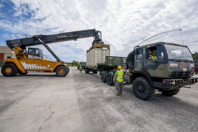 Army Reserve Soldiers load a truck with cargo during Operation Patriot Bandoleer at Military Ocean Terminal Sunny Point, North Carolina, April 14.