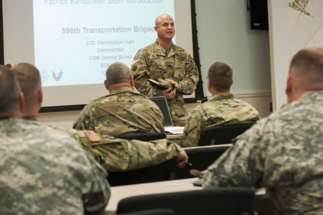 Col. Chris Hart, commander, 596th Transportation Brigade, Military Surface Development and Distribution Command, meets National Guard Soldiers to discuss operational safety, and his terminal's mission and capabilities at Military Ocean Terminal Sunny Point, North Carolina, April 13.