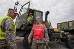 National Guard Soldiers wait for a safety inspection during Operation Patriot Bandoleer at Military Ocean Terminal Sunny Point, North Carolina, April 14.