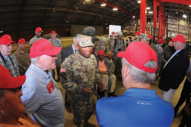 "Brig. Gen. Ronald Kirklin, Quartermaster General, chats with former members of the 383rd Quartermaster Detachment at the ""rigger shack"" facility of the Aerial Delivery and Field Services Department April 20. Thirteen members of the 383rd visited Fort Lee as part of a 50-year reunion."