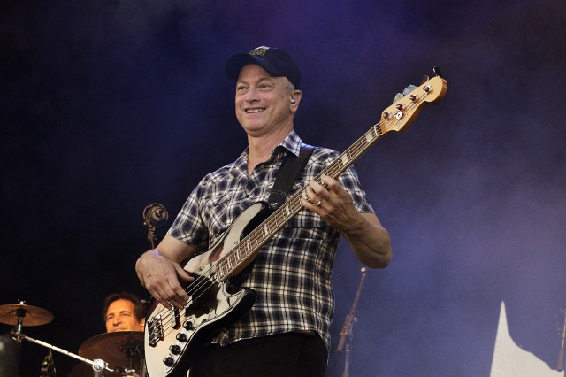 Gary Sinise takes a break from acting to play electric bass guitar in his Lt. Dan Band at Fort Sill's Polo Field.
