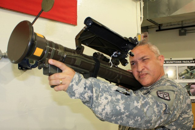 Chief Warrant Officer 2 Luis Alvarado, a student attending phase two of the Warrant Officer Advanced Course for ammunition technicians at McAlester Army Ammunition Plant, Okla., gets the feel of an FIM-92J Stinger missile during a tour of the ammunition and missile maintenance facility April 19.
