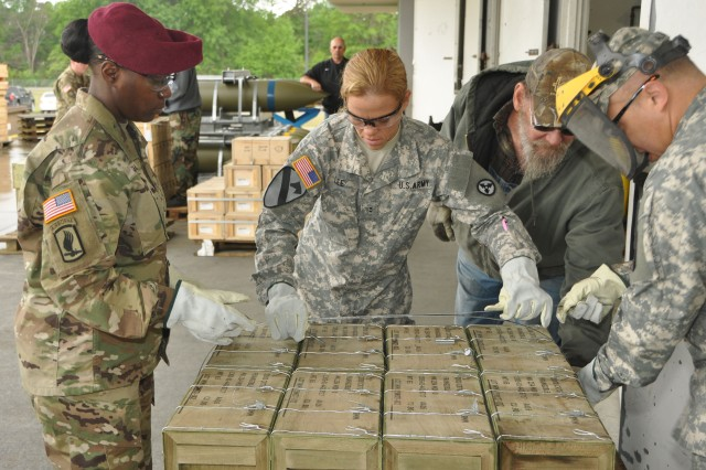 Chief Warrant Officer 2 Jessica Lee (center) is assisted by CW2 Laneki Smith (left) and CW2 Luis Alvarado while banding together munitions at the less-than-a-truckload facility on McAlester Army Ammunition Plant, Okla., April 14. The Soldiers attend phase II of the Warrant Officer Advanced Course for ammunition technicians at the southeast Oklahoma installation.  (U.S. Army photo by Raul Hernandez)