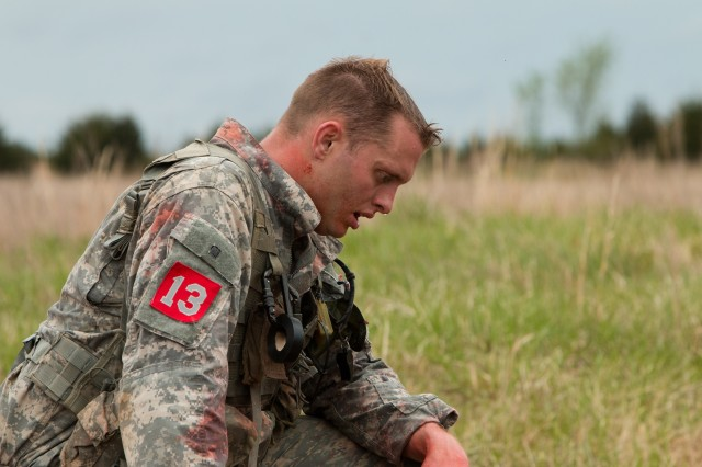 After moving a simulated patient and equipment nearly 200 meters to a casualty evacuation point, Capt. Matthew McGuire takes a knee during the Best Sapper Competition held April 19-21 at Fort Leonard Wood, Missouri. The competition measures the resiliency, physical and mental stamina, and technical and tactical proficiency of top engineers who dare to take on the challenge.