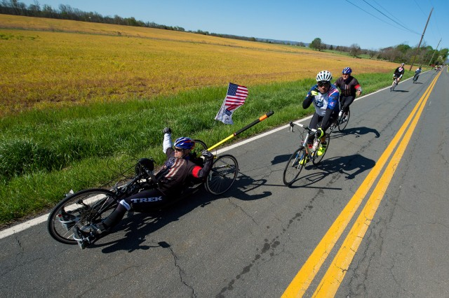 Retired Navy Petty Officer 1st Class Jerry Padgett II, front, sets a pace for his team during the Face of America bike ride in Gettysburg, Pa., April 24, 2016. More than 150 disabled veteran cyclists were paired among 600 able-bodied cyclists to ride 110 miles from Arlington, Va., to Gettysburg over two days in honor of veterans and military members.