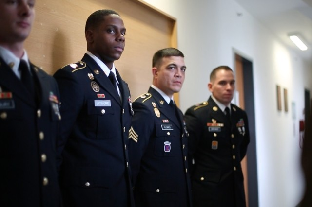 Spc. Samuel Latimore (center left) of the 52nd Signal Battalion, 2nd Signal Brigade, and Sgt. Carlos Flores (center right) of the 39th Signal Battalion, 2nd Signal Brigade, receive an outbrief after completing a formal board during the 5th Signal Command (Theater) Best Warrior Competition, April 27, 2016 in Wiesbaden, Germany.