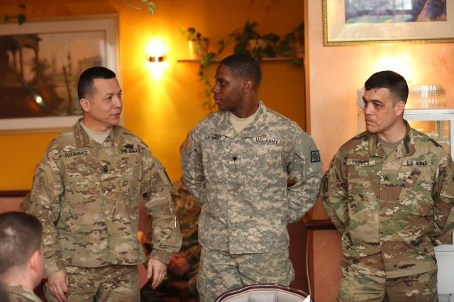 Command Sgt. Maj. Frank Gutierrez, 5th Signal Command (Theater) senior enlisted advisor, congratulates Spc. Samuel Latimore of the 52nd Signal Battalion, 2nd Signal Brigade, and Sgt. Carlos Flores of the 39th Signal Battalion, 2nd Signal Brigade, for being named the 5th Signal Command Soldier and NCO of the year, respectively, at an awards dinner April 27, 2016 at the Community Activity Center on Clay Kaserne in Wiesbaden, Germany.