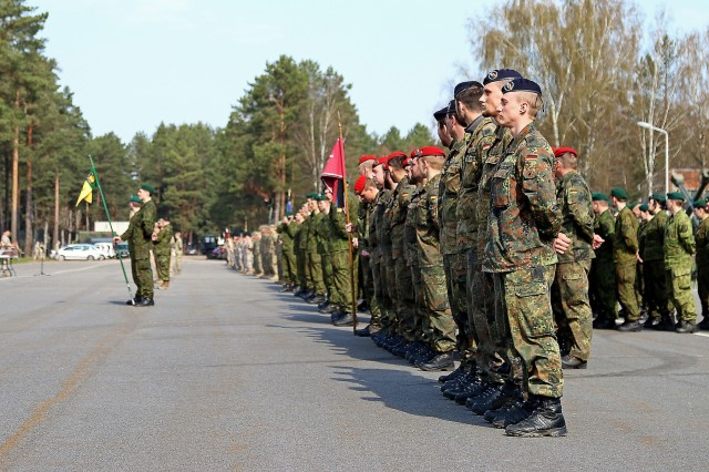 Soldiers of six North Atlantic Treaty Organization nations stand in formation before the closing ceremony of Summer Shield XIII, April 29, at Adazi Military Base, Latvia. Soldiers from Latvia, Canada, Germany, Lithuania and the U.S. have been conducting a variety of training together during Summer Shield XIII, an annual two-week long interoperability training event in Latvia. Soldiers from Finland and Poland were also present as observers. (U.S. Army photo by Sgt. Paige Behringer, 10th Press Camp Headquarters)