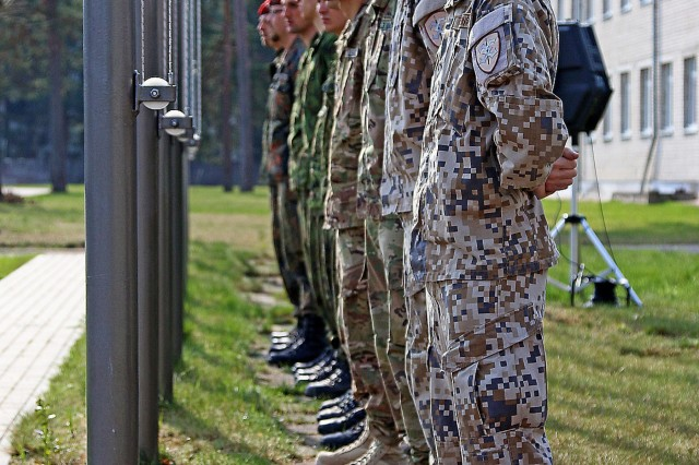 Soldiers from five of the North Atlantic Treaty Organization nations participating in Summer Shield XIII stand ready to lower their country's flag during the closing ceremony of Summer Shield XIII, April 29, at Adazi Military Base, Latvia. Soldiers from Latvia, Canada, Germany, Lithuania and the U.S. have been conducting a variety of training together during Summer Shield XIII, an annual two-week long interoperability training event in Latvia. Soldiers from Finland and Poland were also present as observers.(U.S. Army photo by Sgt. Paige Behringer, 10th Press Camp Headquarters)