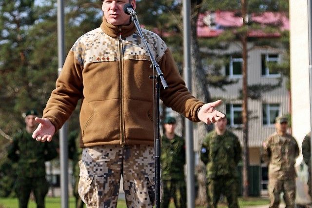 Col. Martins Liberts, land force commander, Latvian army, addresses soldiers from six North Atlantic Treaty Organization nations during the closing ceremony of Summer Shield XIII, April 29, at Adazi Military Base, Latvia. Soldiers from Latvia, Canada, Germany, Lithuania and the U.S. have been conducting a variety of training together during Summer Shield XIII, an annual two-week long interoperability training event in Latvia. Soldiers from Finland and Poland were also present as observers.(U.S. Army photo by Sgt. Paige Behringer, 10th Press Camp Headquarters)