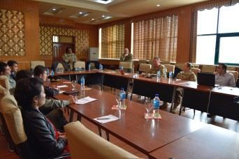 Maj. Neysa Williams, USARCENT public affairs community and media relations officer, discusses community and media relations during a Media Relations Exchange April 20, 2016, in Dushanbe, Tajikistan.