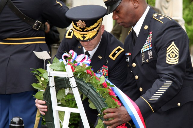 Brig. Gen. Kurt J. Ryan, Chief of Ordnance and Ordnance School commandant, and Command Sgt. Maj. Edward C. Morris, Ordnance Corps regimental command sergeant major, present a wreath at President James Monroe's burial site April 28, at Hollywood Cemetery in Richmond, Va. To pay homage to the nation's leaders, ceremonies like this are held annually at the gravesites of each of the former presidents on their birthday.