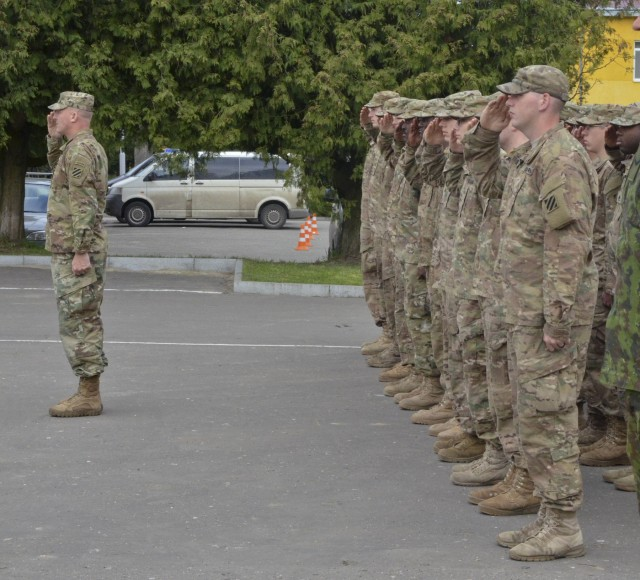 3-15 Infantry Soldiers stand in formation for a JMTG-U graduation ceremony