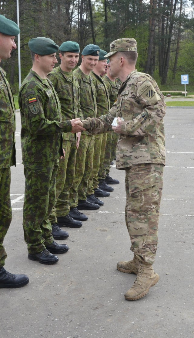 3-15 Infantry Commander presents coins to Lithuanian Soldiers