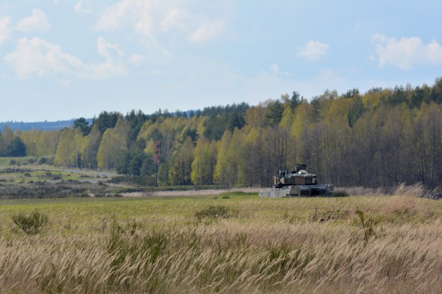 A M1A2 Abrams Main Battle Tank from 2nd Battalion, 7th Infantry Regiment scans the countryside for enemy targets at Grafenwoehr Training Area, Germany during their Tank Gunnery Table VI April 28. The battalion is qualifying tank crews, sections and platoons to make sure they have trained and lethal formations for Exercise Anakonda 16. Anakonda 16 is a Polish-led exercise taking place in Poland June 7-17 with more than 25,000 participants from 24 nations, supporting assurance and deterrence measures by demonstrating Allied defense capabilities to deploy, mass and sustain combat power. (Photo by Maj. Randy Ready)
