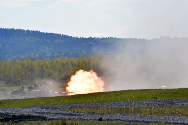 A M1A2 Abrams Main Battle Tank fires at a target as Soldiers from 2nd Battalion, 7th Infantry Regiment shoot Tank Gunnery Table VI at Grafenwoehr Training Area, Germany April 28. The battalion is qualifying tank crews, sections and platoons to make sure they have trained and lethal formations for Exercise Anakonda 16. Anakonda 16 is a Polish-led exercise taking place in Poland June 7-17 with more than 25,000 participants from 24 nations, supporting assurance and deterrence measures by demonstrating Allied defense capabilities to deploy, mass and sustain combat power. (Photo by Maj. Randy Ready)