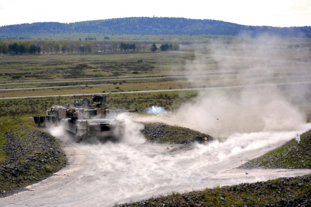 A M1A2 Abrams Main Battle Tank kicks up the dust after firing at a target as Soldiers from 2nd Battalion, 7th Infantry Regiment shoot Tank Gunnery Table VI at Grafenwoehr Training Area, Germany April 29. The battalion is qualifying tank crews, sections and platoons to make sure they have trained and lethal formations for Exercise Anakonda 16. Anakonda 16 is a Polish-led exercise taking place in Poland June 7-17 with more than 25,000 participants from 24 nations, supporting assurance and deterrence measures by demonstrating Allied defense capabilities to deploy, mass and sustain combat power. (Photo by Maj. Randy Ready)