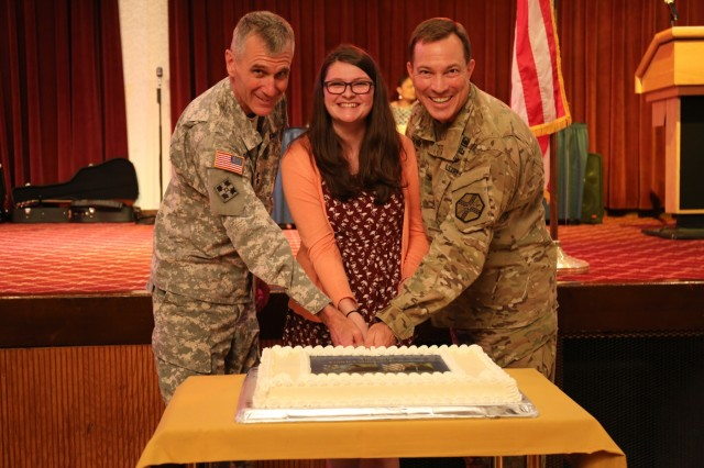 Regan Andersen, awarded Outstanding Youth Volunteer of the Year, conducts a cake-cutting ceremony with Maj. Gen. James F. Pasquarette and Col. William Johnson, commanders of USARJ and USAG Japan, respectively, annual Youth Volunteer Recognition Ceremony held April 28 at the Camp Zama Community Club. (U.S. Army photos by Noriko Kudo)