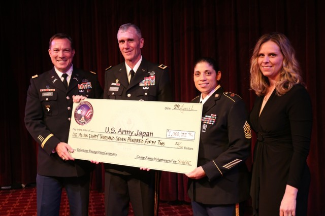 U.S. Army Japan leaders display a check for $1,080,752.52, the amount saved in the past year by work without pay from volunteers. Several of those volunteers were recognized during the annual Volunteer Recognition Ceremony held April 29 at the Camp Zama Community Club. (U.S. Army photos by Noriko Kudo)