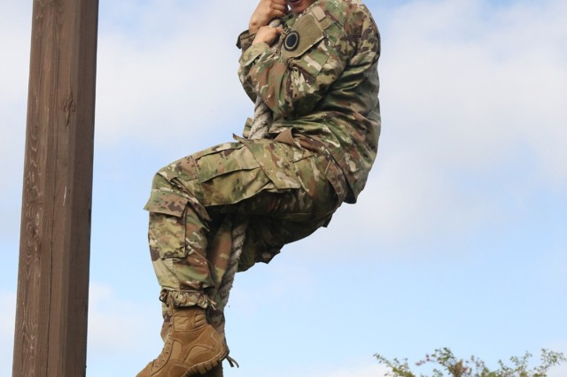 Spc. Lucas Patron, wheel vehicle mechanic assigned to I Corps Forward, participates in the rope climb during the obstacle course April 26 at Camp Fuji, Japan for the USARJ 2016 Warrior Challenge Competition. (U.S. Army photo by Lance D. Davis)