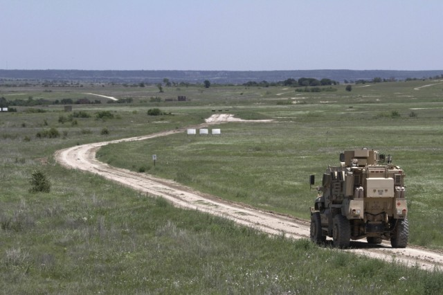 A Mine Resistant Ambush Protected vehicle travels down a muddy road during a training exercise at Fort Hood's Pilot Knob Multi-Use range April 27. (Photo by Staff Sgt. Tomora Clark, 3rd Cavalry Regiment Public Affairs NCOIC)