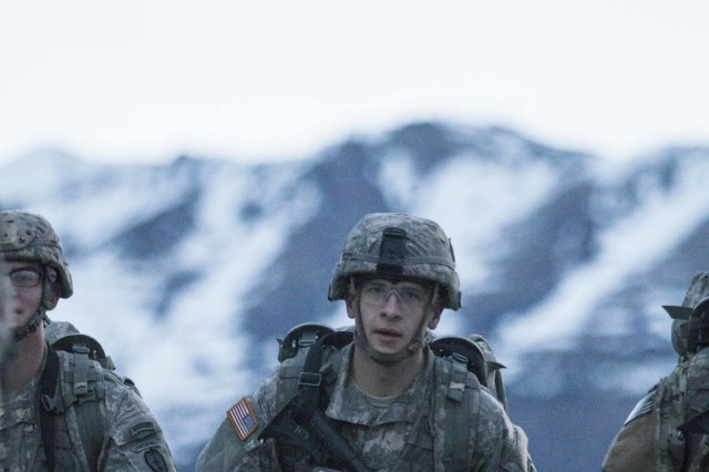 Paratroopers with the 4th Infantry Brigade Combat Team (Airborne), 25th Infantry Division, race to complete a forced 12-mile foot march during testing for the Expert Infantryman Badge at Joint Base Elmendorf-Richardson, Alaska, April 29, 2016.
