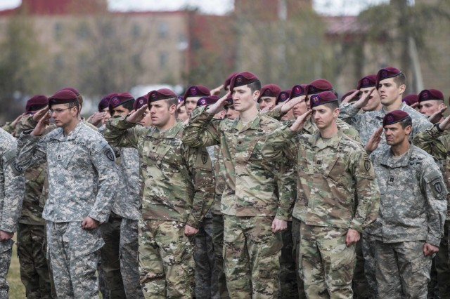 Paratroopers with 1st Battalion, 501st Parachute Infantry Regiment, 4th Infantry Brigade Combat Team (Airborne), 25th Infantry Division, salute during playing of the National Anthem at the Expert Infantryman Badge ceremony on Pershing Field at Joint Base Elmendorf-Richardson, Alaska, April 29, 2016.