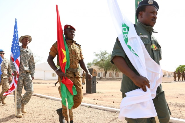 International troops supporting U.S. Army Africa's Western Accord 16 march with their prospective flags prior to the exercise's Opening Day Ceremony May 2, 2016 at Camp Zagre, Ouagadougou, Burkina Faso. Western Accord 16 is an annual combined, joint exercise designed to increase the ability of African partner forces and the U.S. to exercise participants' capability and capacity to conduct African Union/United Nation mandated Peace Operations. (U.S. Army photo by Staff Sgt. Candace Mundt/Released)