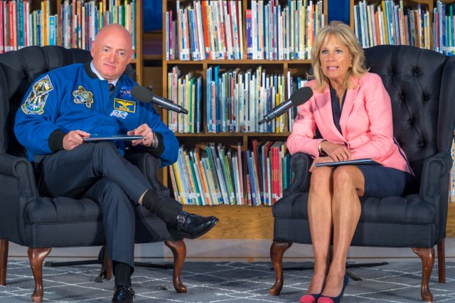 "Dr. Jill Biden joined Mark Kelly in reading ""Mousetronaut"" to students at Thayer Elementary School during a story-time event Tuesday. The book was written by Kelly, who flew four shuttle missions and was a member of the U.S. Navy."