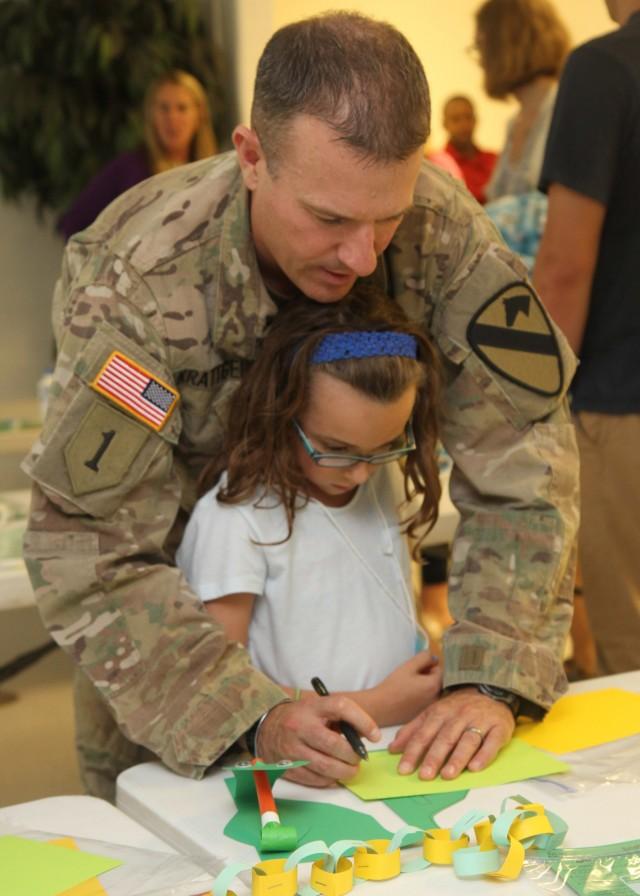 First Team commander reads for children