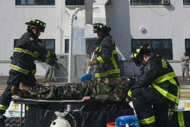 Members from the Fort Belvoir Fire Department, practice decontamination procedures during a full-scale decontamination exercise at Davison Army Airfield, Fort Belvoir, Virginia, April, 25, 2016.