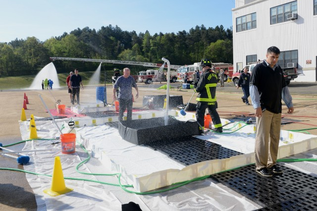 Volunteers and Members from the 12th Aviation Battalion, The Army Aviation Brigade, Fort Belvoir Fire Department, Fort Belvoir Community Hospital and Davison Army Airfield Operations participate in a decontamination exercise at Davison Army Airfield, Fort Belvoir, Virginia, April, 25, 2016.