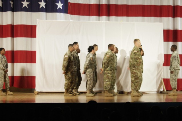 Soldiers stand in formation during the Sexual Assault Sexual Harassment Awareness skit April 28 at Howze Theater here. The skit had 24 Soldier actors from across the 1st Cavalry Division. (Photo by Staff Sgt. Tomora Clark, 3rd Cavalry Regiment Public Affairs NCOIC)