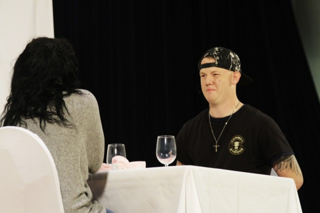 Spc. Richard Wilcoxson, a Soldier in 3rd Armored Brigade Combat Team, goes out to eat with his female commander during the Sexual Assault Sexual Harassment Awareness skit April 28 at Fort Hood's Howze Theater. (Photo by Staff Sgt. Tomora Clark, 3rd Cavalry Regiment Public Affairs NCOIC)