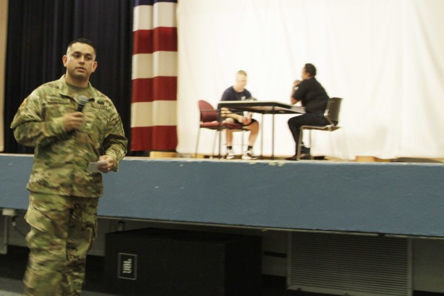Sgt. 1st Class Raymundo Rodriguez, the sexual assault response coordinator for 3rd Cavalry Regiment, talks to the audience in-between each Sexual Assault Sexual Harassment Awareness skit April 28 at Fort Hood's Howze Theater. Rodriguez said, the interactive training was important to ensure the audience understands the training. (Photo by Staff Sgt. Tomora Clark, 3rd Cavalry Regiment Public Affairs NCOIC)