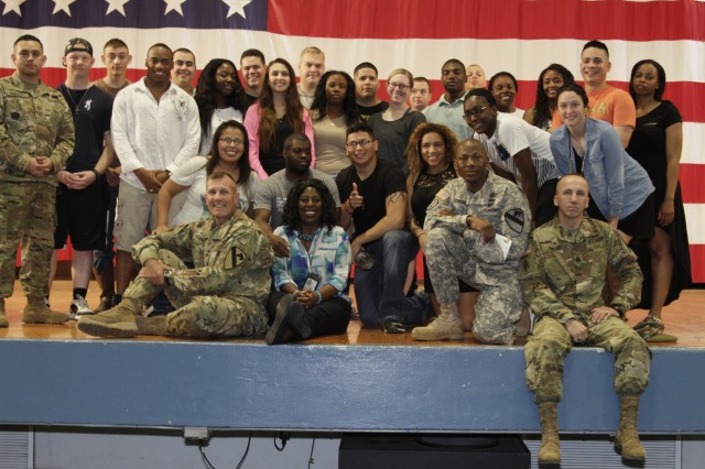 The cast members of a Sexual Assault Sexual Harassment Awareness skit pose with the 1st Cavalry Division's command team after the performance April 28 at Howze Theater here. (Photo by Staff Sgt. Tomora Clark, 3rd Cavalry Regiment Public Affairs NCOIC)