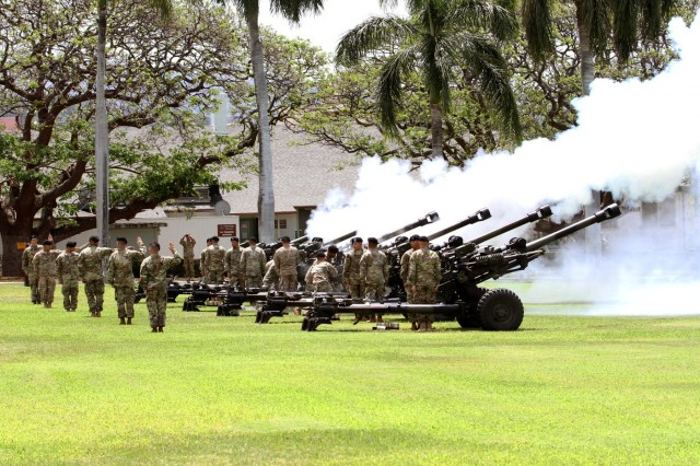 Soldiers with 3rd Brigade, 7th Field Artillery, 25th Infantry Division Salute Battery, honors the in-coming and out-going U.S. Army Pacific Commanding General with a gun salute during the beginning of the change of command ceremony between, Gen. Vincent K. Brooks and Gen. Robert B. Brown. (U.S. Army photo by Staff Sgt. Kyle J. Richardson)
