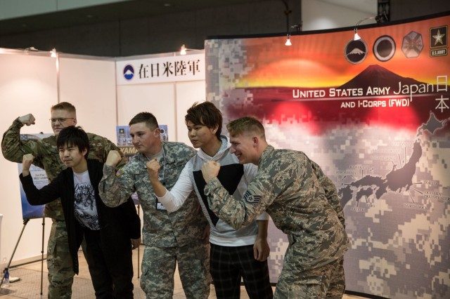 Soldiers and Airmen from Camp Zama pose for pictures with super-convention attendees at USARJ's information booth during Niconico Chokaigi 2016. The super-convention is sponsored by Niconico, Japan's largest social video website, and attracted more than 157,000 attendees and 5.5 million viewers over the internet. (U.S. Army photo by Randall Baucom)