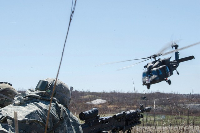"Soldiers with B Company ""Bushmasters,"" 2nd Battalion, 22nd Infantry Regiment, 1st Brigade Combat Team, 10th Mountain Division (LI) secure a medical evacuation landing zone during a combined-arms live-fire exercise in the Fort Drum training area April 26."