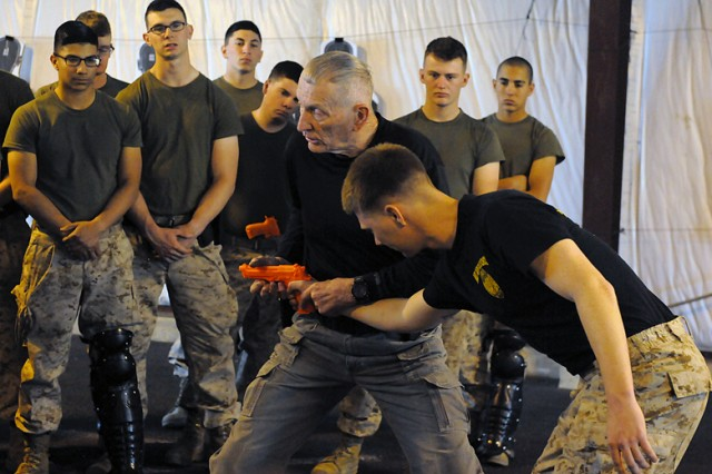 "Walter Bunt demonstrates disarming techniques to Marine Corps Military Police Basic Course students at ""Heartbreak Ridge"" on Fort Leonard Wood. Bunt has been an instructor here since 2008."