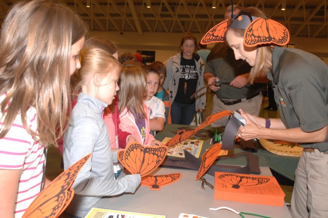 Kendra Swee, Missouri State Parks interpretive resource coordinator, helps area elementary school children make monarch butterfly headbands Friday at the Fort Leonard Wood Earth Day Fair and Celebration at Nutter Field House. Hundreds of community members took part in the event featuring educational exhibits and numerous hands-on activities.
