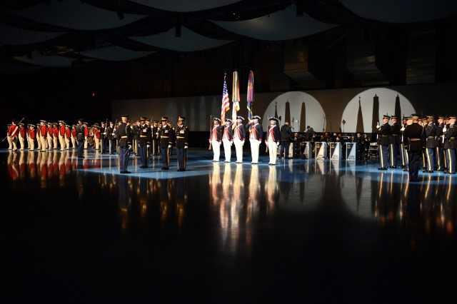 Soldiers from the 3rd U.S. Infantry Regiment (The Old Guard) stand at the beginning of Twilight Tattoo in Conmy Hall on Joint Base Myer-Henderson Hall, Virginia, May 4, 2016. Twilight Tattoo is a free, one-hour military history show performed all summer long on Joint Base Myer-Henderson Hall.