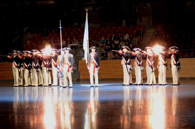 Soldiers from the 3rd U.S. Infantry Regiment (The Old Guard) Commander-in-Chief's Guard fire muskets during the kick-off performance of Twilight Tattoo May 4, 2016, in Conmy Hall on Joint Base Myer-Henderson Hall, Virginia. Twilight Tattoo is a free, one-hour military history show performed all summer long on Joint Base Myer-Henderson Hall.