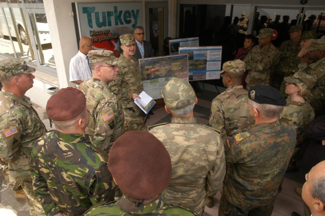 Logisticians and other leaders from several allied countries learn about port operations in Turkey from Lt. Col. Jason Alvis, commander, 839th Transportation Battalion, speaking, after touring the port of Izmir, Turkey, April 26 as part of the Southern Sustainment Terrain Walk organized by the 21st Theater Sustainment Command.